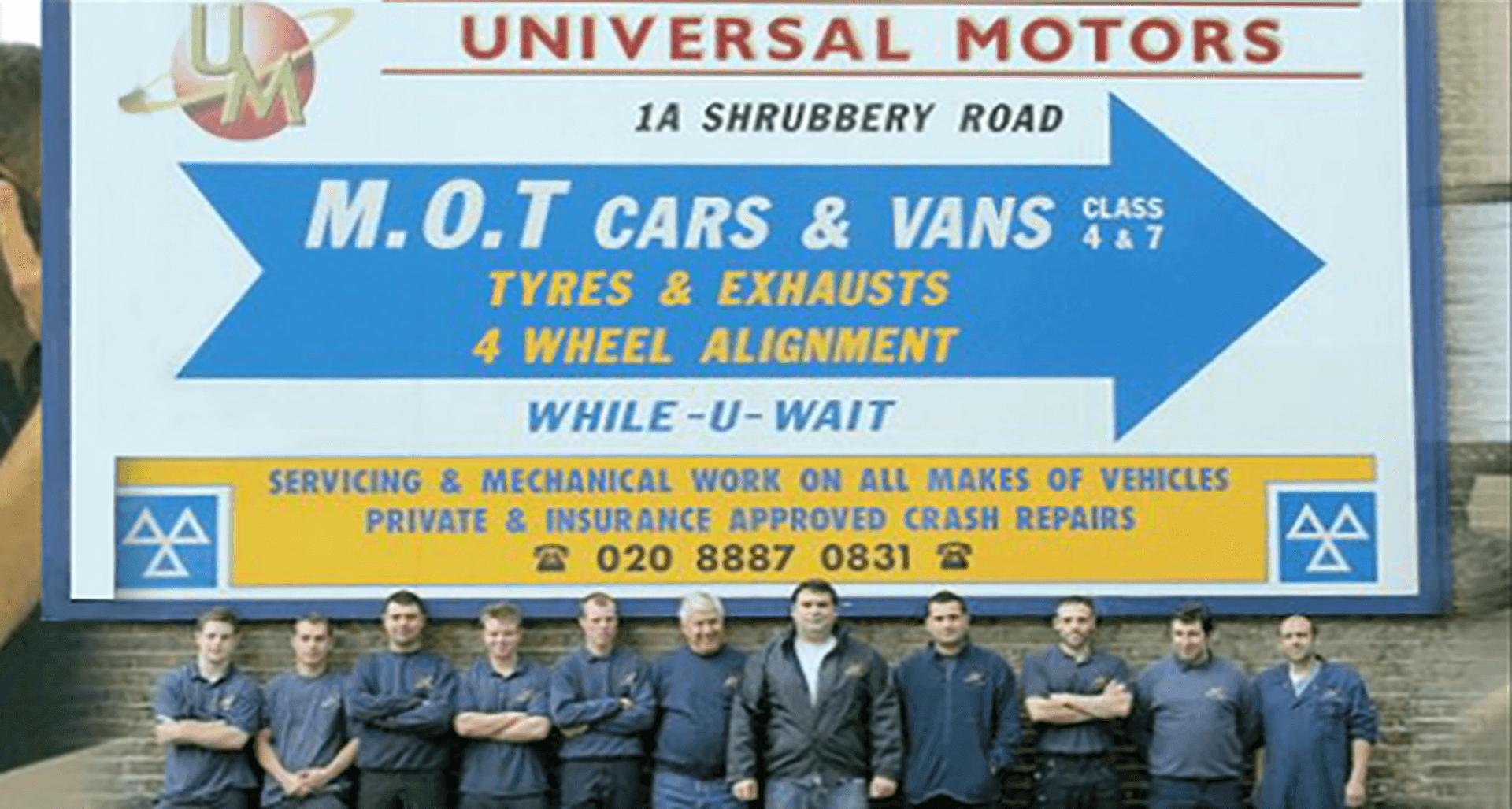 All mechanics under billboard