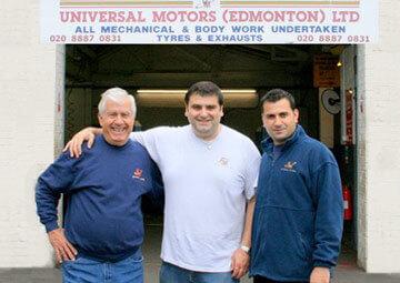 Mechanics standing outside of garage